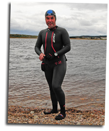 Mike prepares to swim across the River Spey